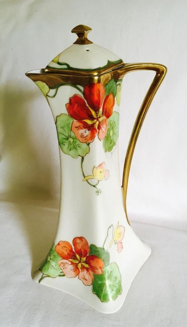 Vintage hand painted Limoges France chocolate pot. Measures 11 tall. No chips, no cracks, image clear and bright.