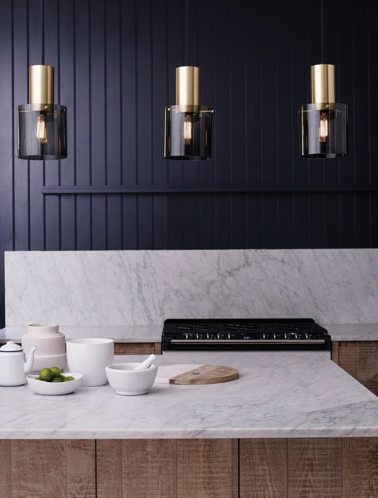 The striking 'Walter' pendant light from Original BTC embodies Sixties chic. The fashionable pairing of brushed satin brass and glass oozes glamour, making it a perfect choice to illuminate your kitchen. The shade is hand-blown and polished for a pristinely neat finish. It is available in Opal off-white or Anthracite black, in two size options and as a table or pendant light (as shown). From £345. originalbtc.com