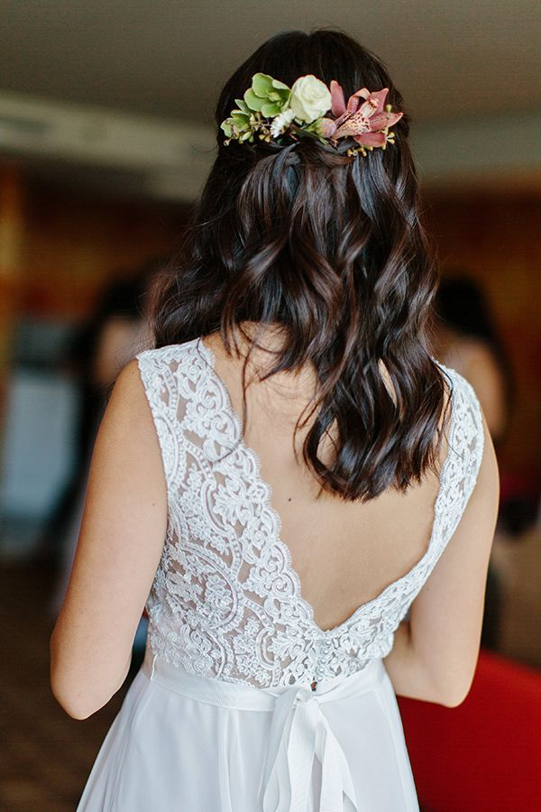 The bride wore an orchid and hellebores in her hair. | Photo by Marissa Kay Photography