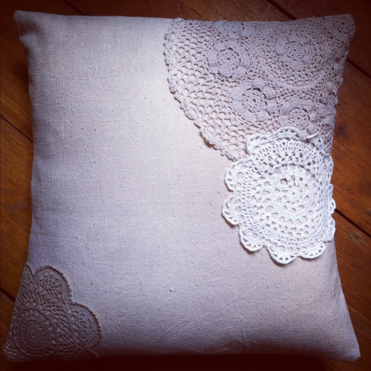 Burlap cushion cover with vintage doilies