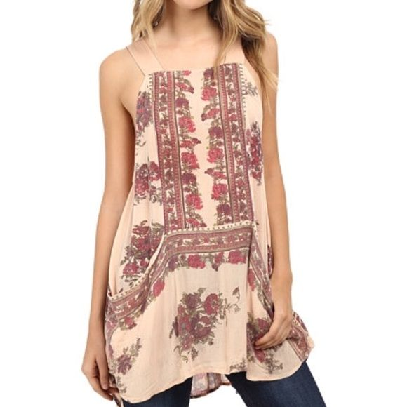 Free People Paradise song printed Tunic This tunic looks great with jeans and shirts! Worn only twice! In excellent condition! Free People Tops Tunics