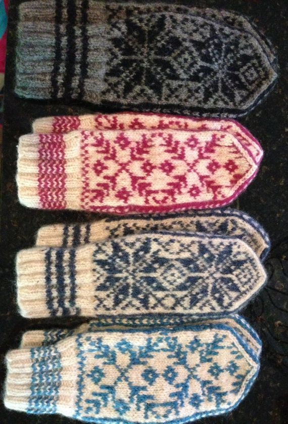 Mittens knit in the traditional Norwegian patterns. 100% wool recycled from sweaters. These mittens are very warm and comfortable to wear.