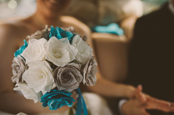 Wedding bouquet made out of white, turquoise and grey paper. http://johannahietanen.com/wedding/haakuvaus-tampere/