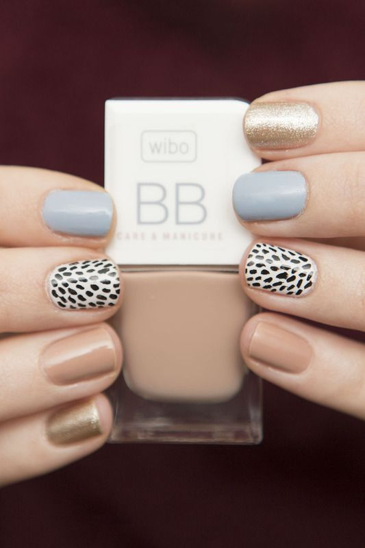 spring neutral nails with a black and white patterned accent nail.
