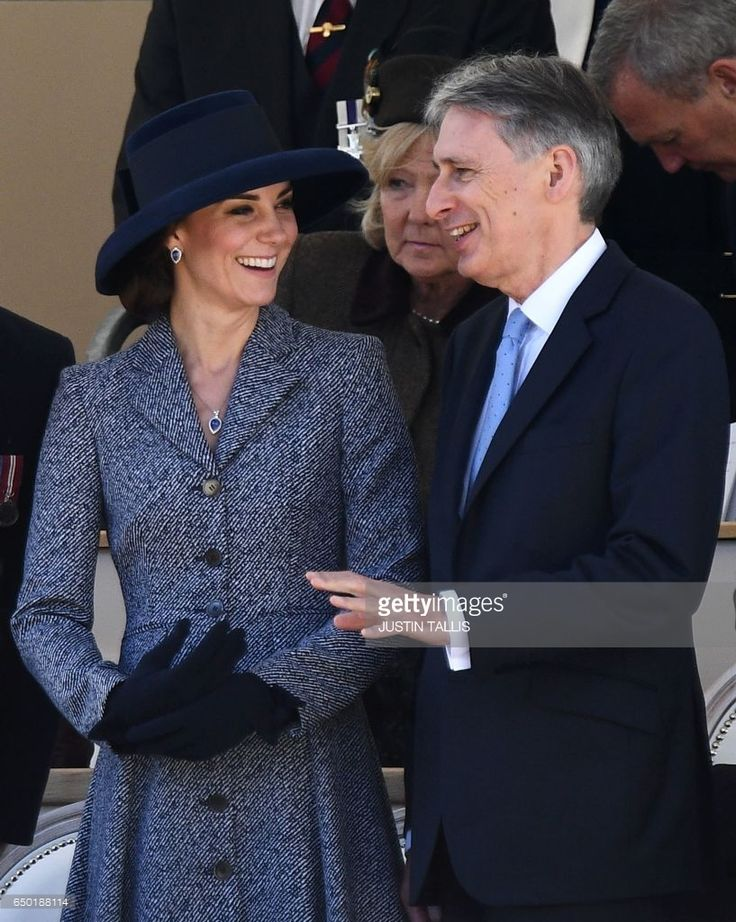 Britain's Catherine, Duchess of Cambridge (L) smiles a she talks to British Chancellor of the Exchequer, Philip Hammond (R) as they attend a Service of Commemoration and Drumhead Service on Horse Guards Parade in central London on March 9, 2017, which honours the service and duty of both the UK Armed Forces and civilians in the Gulf region, Iraq and Afghanistan, and those who supported them back home, from 1990-2015.After the Drumhead Service, The Queen will officially unveil The Iraq and…