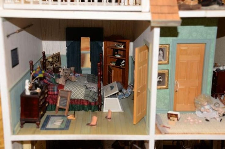 Large doll house on stand with twelve fully furnished rooms. total ht. 72in. table top: 28