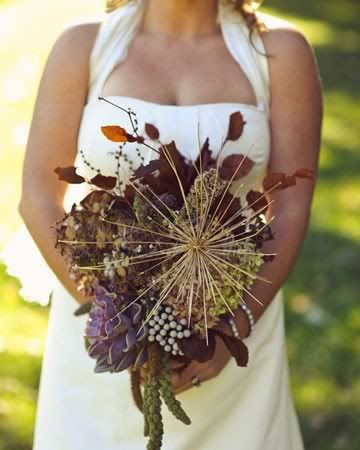 The bouquet arrangement includes a dried Star of Persia, dried agapanthus, succulents, silver brunia, copper beech, seedpods, and branches while the centerpiece is composed of assorted vessels holding dried allium, moss, and bittersweet branches. Are you loving this like I am?
