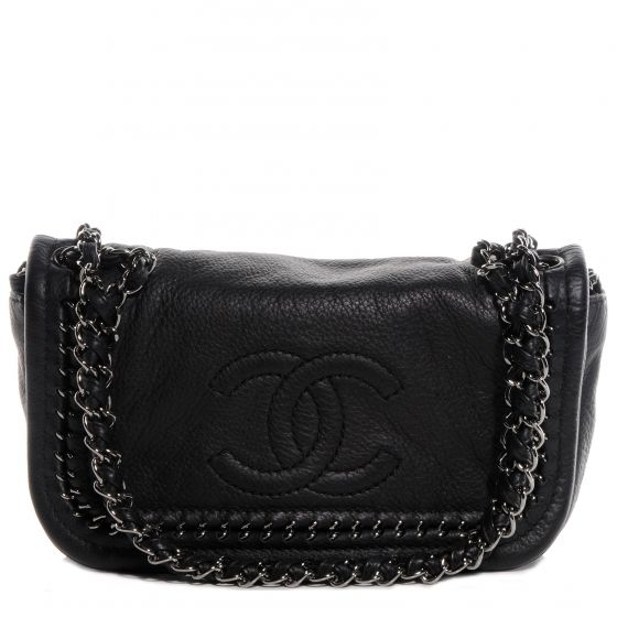 This is an authentic CHANEL Deerskin Luxe Ligne Small Flap Bag in Black.   This chic shoulder bag is crafted of luxurious deerskin leather with a large embossed Chanel CC at the front of the bag.