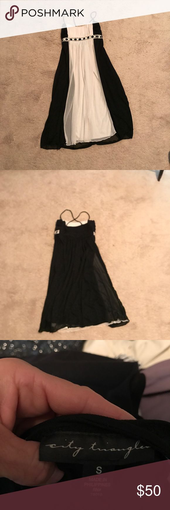 Black And White cocktail dress Black And White cocktail dress crisscross straps in the back. To the knee size small City Triangles Dresses