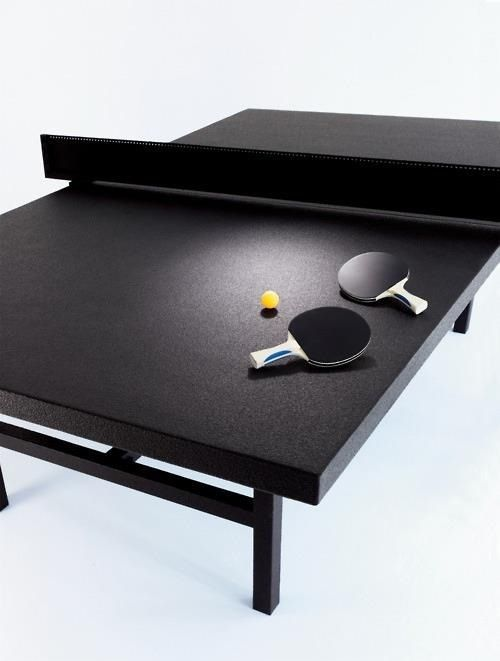 All black table tennis color design except for the ball which is color yellow.  A colored black table tennis is perfect on a playing area with a bright or white background.
