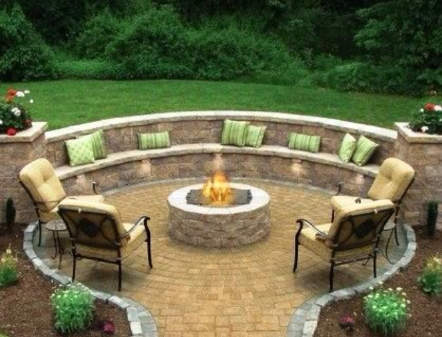 Beautiful outdoor fire pit. Love the seating built into the wall.