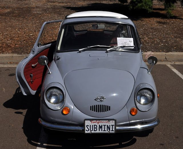 1967 Subaru 360, so small it fits in a pickup truck bed