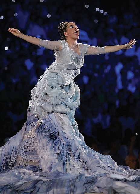 """bjork 2004 - """"Oceana"""" at the Athens Olympic Ceremony. An amazing dress that spread out as she sang, her dress slowly unfurled to reveal a 10,000 square foot map of the world, which she let flow over all of the Olympic athletes."""