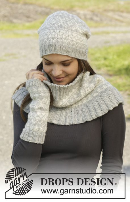 """Knitted DROPS hat, neck warmer and wrist warmers with Norwegian pattern in """"Karisma"""". ~ DROPS Design"""
