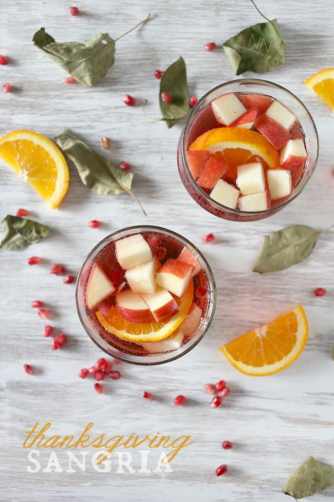 This simple Thanksgiving sangria is packed full of pomegranate seeds, apple, orange, semi sweet red wine and champagne. This drink is perfect for your holiday table.