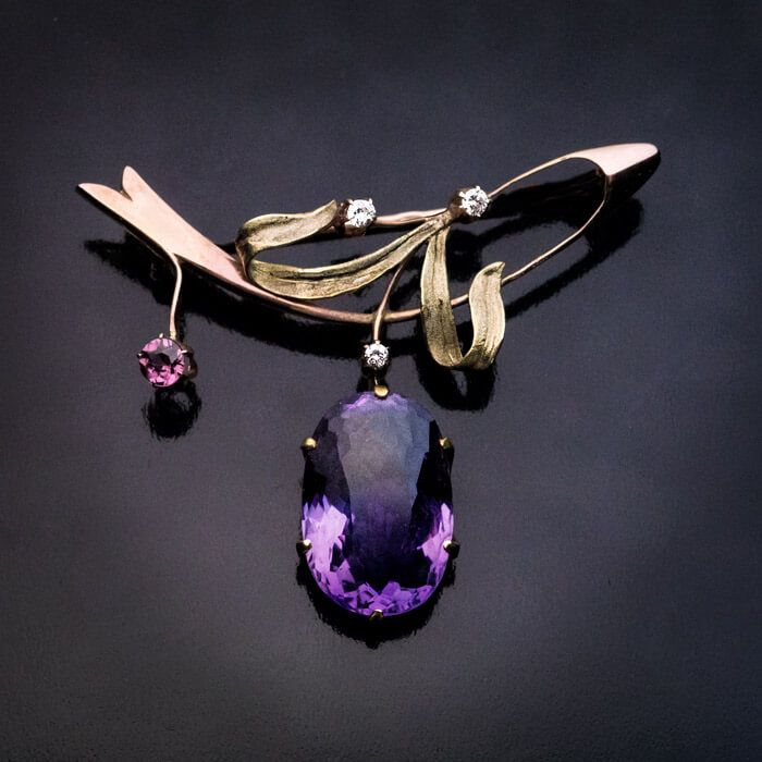 Antique Art Nouveau Russian Amethyst Gold Brooch Pin, Moscow, 1899-1908. A rose and green 14K gold brooch is designed as a branch with berries. The brooch is set with an oval amethyst, a pink tourmaline and three diamonds.