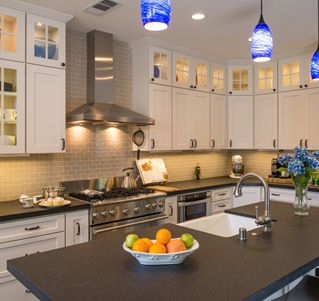 Exceptional San Benito Leather Granite with a Block edge highlights this San Diego kitchen remodel.