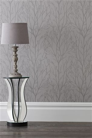 If you're styling a silver/grey bedroom, this 'Pewter Twigs' wallpaper from the Next UK online shop would be perfect.