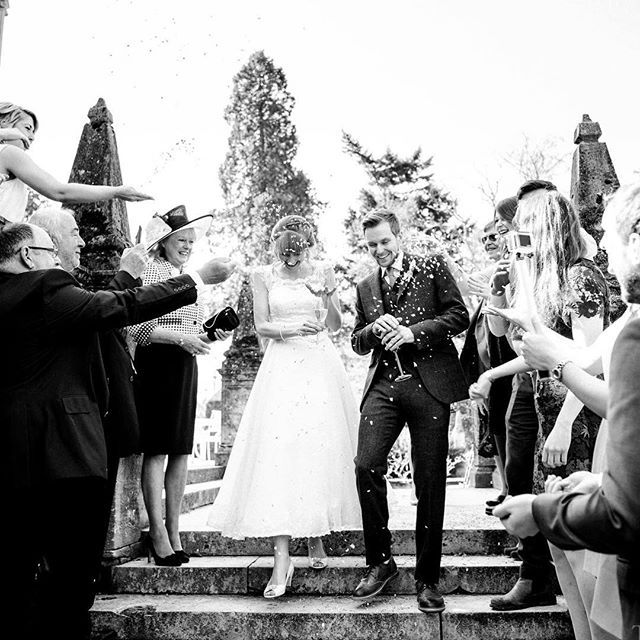 Confetti assault at @tylneyhallgardens! Carla & Mark had the presence of mind to protect the champers!!! This ones on the blog. Follow the link in my Instagram profile. #ontheblog #justblogged #blackandwhite #tonyhartphoto #documentaryweddingphotography #weddingphotojournalism #narrative #storytellingphotography #confetti #weddingconfetti #instawedding #bride #groom #justmarried #tylneyhallwedding #tylneyhall #brownsuit #weddingdress #steps