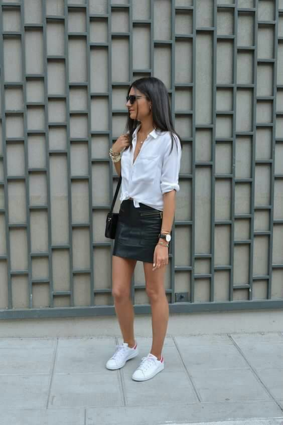 street style - black leather mini skirt, white shirt, white sneakers (fall - winter)