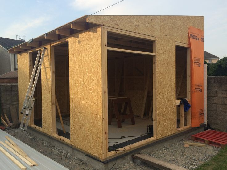 Workshop construction, timber frame, OSB sheeting, monopitch roof.