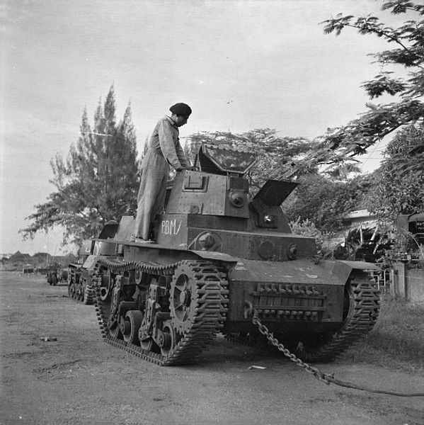 Battle of Surabaya: A soldier of an Indian armoured regiment examines a light tank (Marmon-Herrington CTLS) used by Indonesian nationalists and captured by British forces during the figthing in Surabaya (Soerabaja).