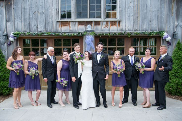 Wedding party in front of old rustic barn at wedding in Aylmer