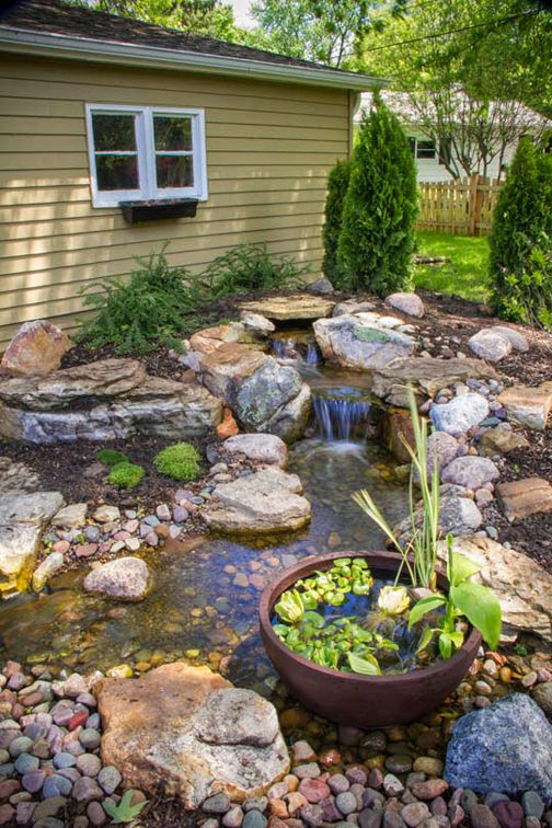 Backyard waterfall. Creates soothing sound of water and attracts birds and butterflies.
