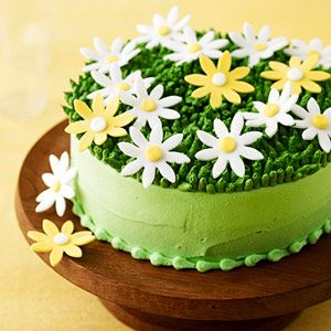 Colored fondant makes the pretty daisies that top this light green frosted cake. Impress guests when you serve it for Easter dinner or any spring party.: Easter Dinners, Green Frostings, Cakes Mixed Daisies, Spring Parties, Cakemix Daisies, Frostings Cakes, Daisies Cakes, Color Fondant, Impressions Guest