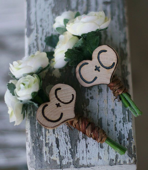 Personalized heart charm boutonniere |  Photos: Courtesy of Bragging Bags
