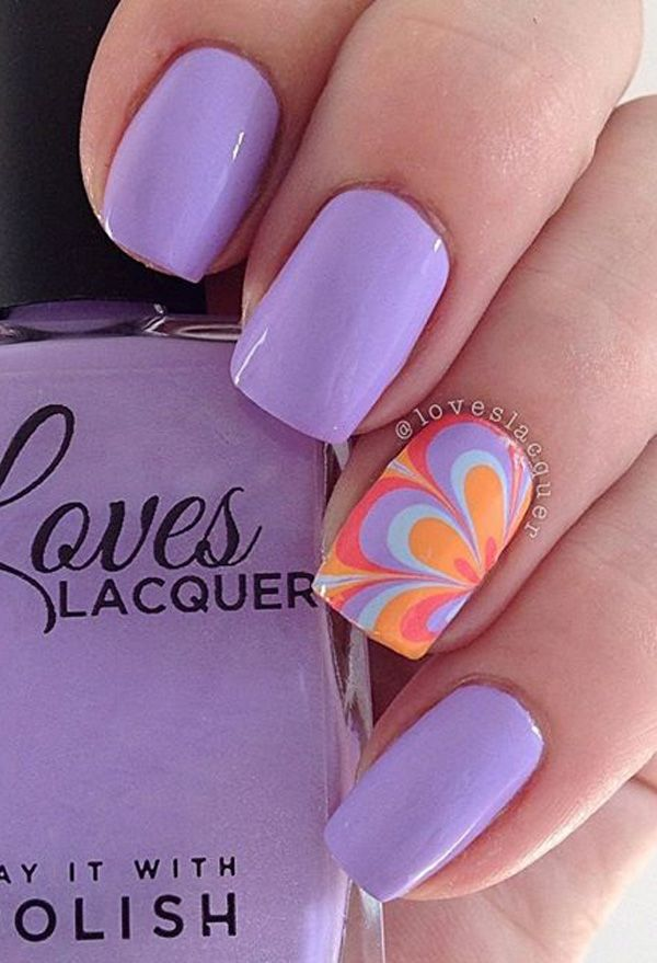 A really pretty Purple nail art design. The matte nails make the single flower design stand out. The flower design also has a multi color which sets it apart from the sea of matte purple polish.