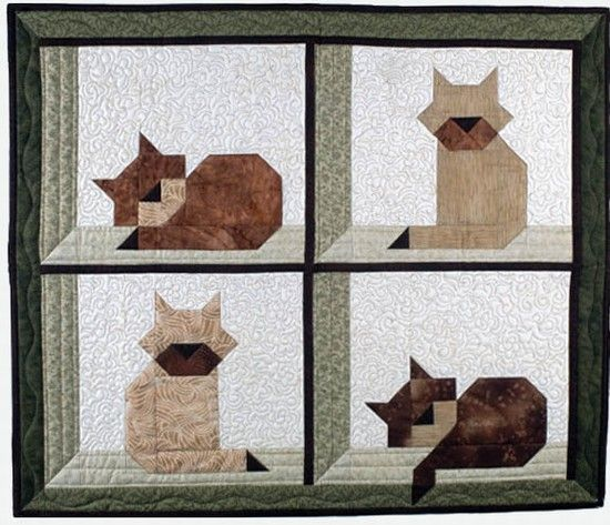 Two free pieced cat blocks, could be used in any layout in a kid quilt.