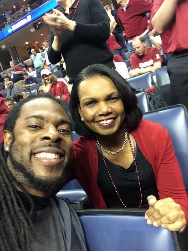 Basketball fans Richard Sherman and Condoleezza Rice at the NCAA ...