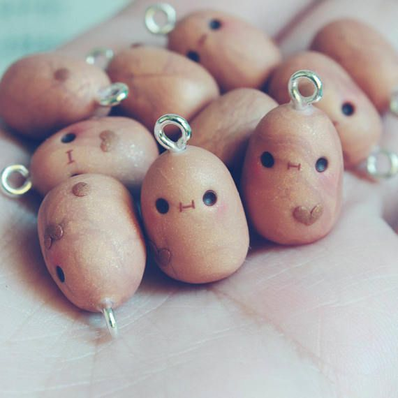 *These are sold separately*  These adorable potatoes are inspired by the very cute digital drawing called the derp potato or kawaii potato Made out of polymer clay/oven bake clay  These charms can be used as keychains,necklaces and adorable accessories with your hearts desire  Other charms may vary from looks and size as they are handmade to be just as cute as the previous ones  Care is much needed with these handmade items as they may be affected by too much friction or anything that ...