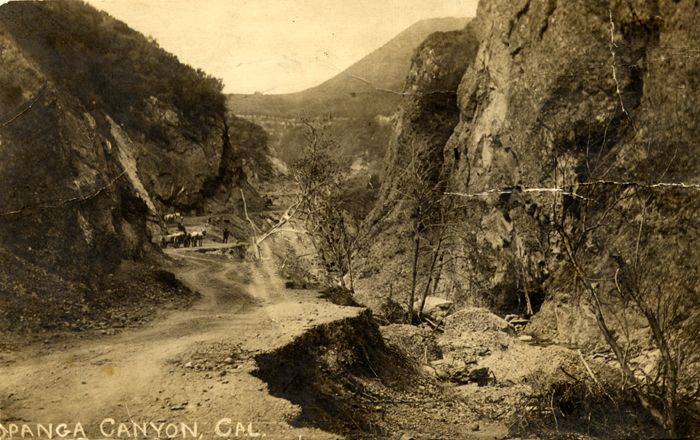"Topanga Canyon Road under construction, circa early 1900s. In the background is visible Pedro Orsua and a team of horses. This image was donated by Laura B. Gaye, from her book ""Land of the West Valley."" San Fernando Valley History Digital Library."