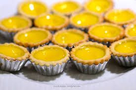 Egg Tart (' dan ta' in Mandarin).  A kind of pastry popular in Asia, particularly in Hong Kong, egg tarts consist of a flaky outer crust, with an egg custard filling. The western equivalent is a custard tart. You can discover egg tarts in the majority of Hong Kong and Chinese bakeshops and dim sum dining establishments. http://www.thegreenbook.com/products/egg-tart/