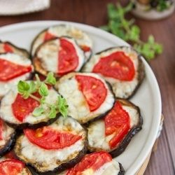 Completely addictive Oven baked eggplant slices with melted mozzarella and tomatoes.
