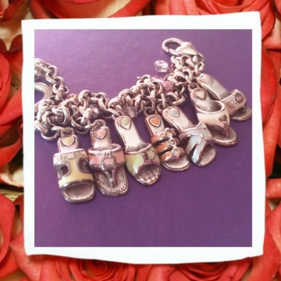 "Retired Brighton Sandals Charm Bracelet Seven shoe (Sandal) bracelet. Each shoe is a different, delicate, pastel color. Gently colored beads are set between each shoe charm. Bottom of each shoe has either hearts or Brighton emblem. Heart clasp closure. Approximately 9""L. Brighton Jewelry Bracelets"