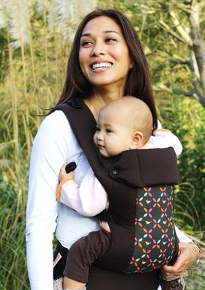 I LOVE the beco gemini carrier - it's awesome, you can face in or OUT (ergo can't do that), back carry & hip carry :)