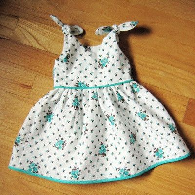 Itty Bitty Baby Dress...newborn or 0-3mos...this took me 1.5 fat quarters of outer fabric and .5 fat quarter inner fabric (or remnant). The straps seem pretty short, so maybe lengthen them. The directions don't mention about finishing any interior seams, so remember to do that. :)