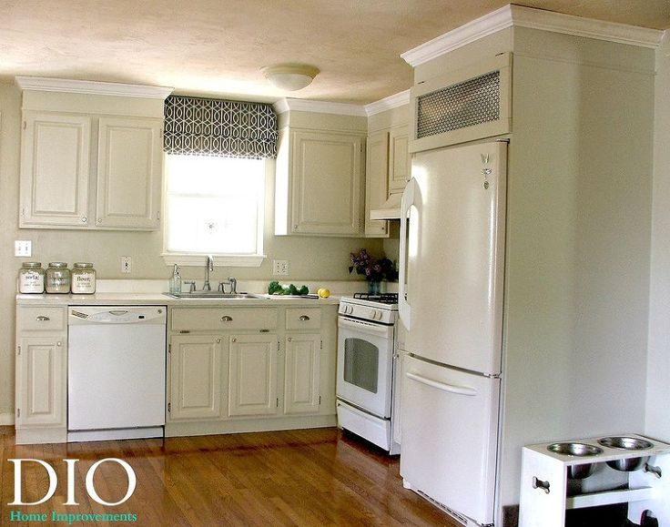 Think I'm going to do the unthinkable...paint my oak cabinets! I really like this!