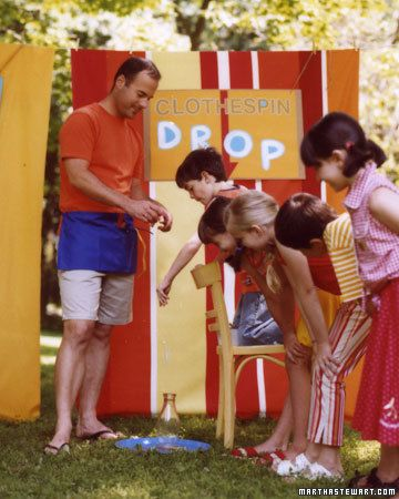 Clothespin Drop Game Kids need good aim, a steady arm, and nerves of steel to succeed at this game: dropping a clothespin into the mouth of a glass bottle. The prize: one ticket. At this or any of the activities, contestants can get back in line for another turn.