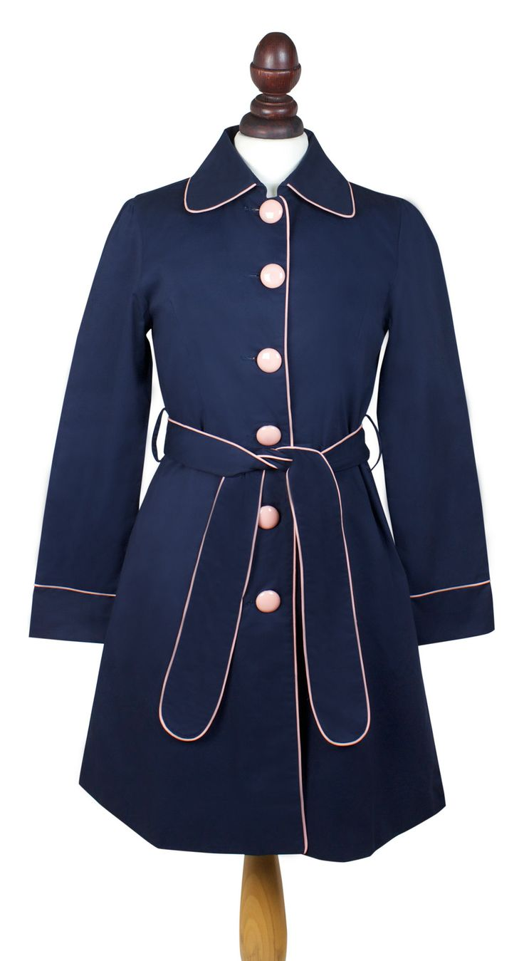 Verity Mac. Classic navy trench coat with pink piping.