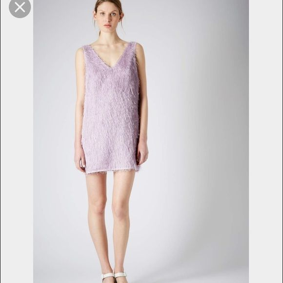 """TOPSHOP Dress Gorgeous lavender NWOT (just plastic tag still hanging on side and label), """"purple all over fringe slip dress"""" from Topshop. This is beyond stunning! Alluring deep V cut in back. Fully lined.Measures 31.5"""" in length and 17"""" across chest. Wear on a special date night Sold out dress! TOPSHOP Dresses"""
