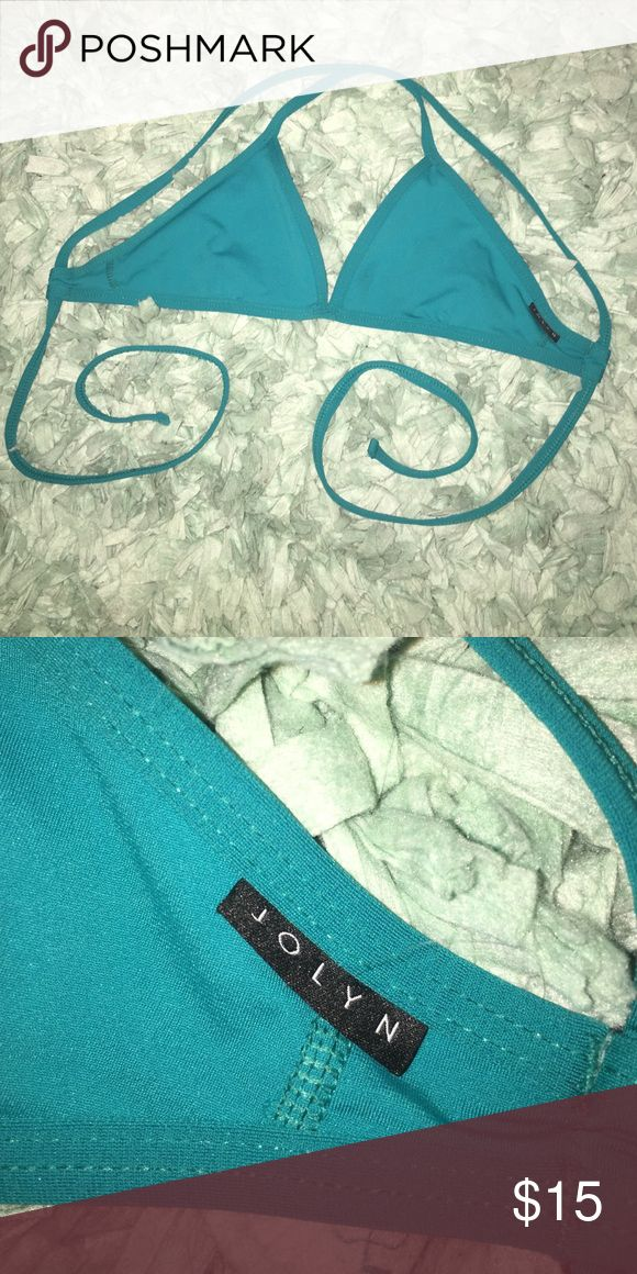 Jolyn Turquoise Triangle Swim Top Small triangle swim top with adjustable tie straps by Jolyn Clothing in turquoise. It has only been worn a handful of times and is in great condition (I purchased the wrong size). I absolutely love these suits and they hold up great in pools, ocean, or land! Jolyn Clothing Swim Bikinis