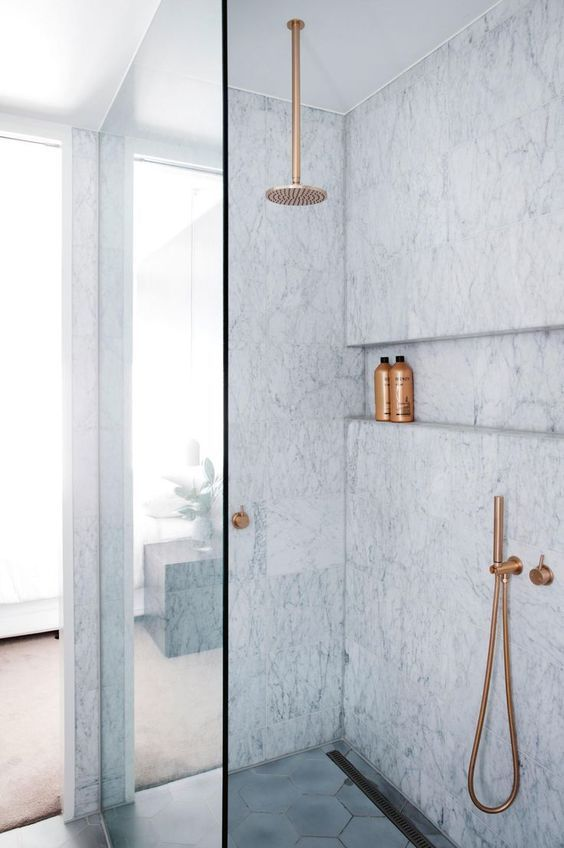 Love this built-in shelf in the shower as an alternative to a niche   modern marble shower with hexagon floor tile