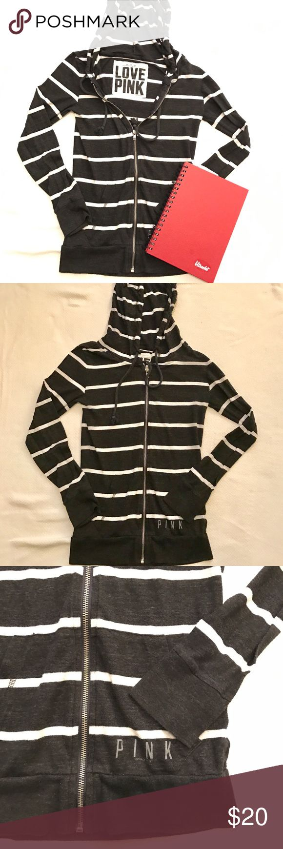 PINK Victoria secret striped zip up hoodie Black and white zip up hoodie in size XS.  Light weight sweater.  Tiny bleach spot on the back.  Please see last two pictures. PINK Victoria's Secret Sweaters