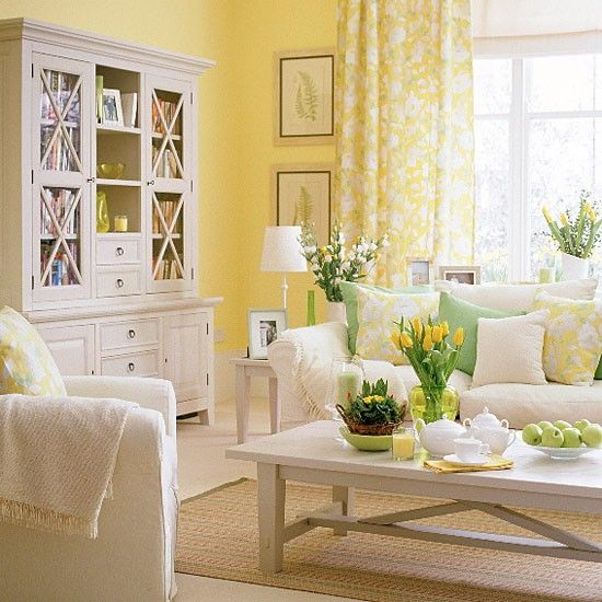 Spring Country Living Room ~ Be inspired by nature with spring-fresh colours in your living room. Yellow walls and floral curtains from Osborne & Little are a perfect backdrop to creamy furniture including a Sofa Workshop sofa