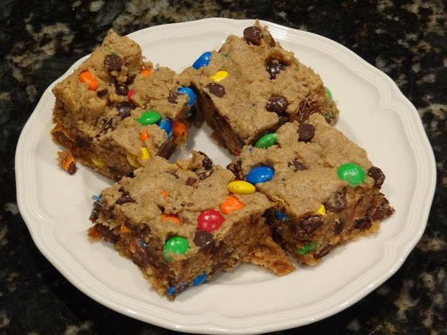 pThese are the BEST monster cookie bars in the entire world! Literally 1-inch in thickness, these bars are chewy, gooey, moist and 10x better than regular ole monster cookies. The combination of peanut butter, chocolate chips, MMs, and oats creates the most decadent cookie bar youll ever put in your /p
