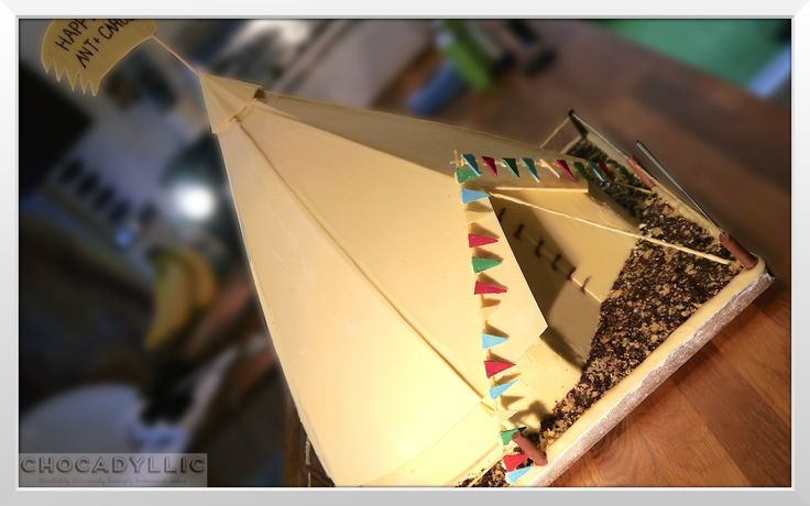 "Ant & Carol's 50th bday Bell Tent cake - Brighton to Devon - a big cake for 100 guests - over 24"" tall with choc & vanilla sponge n oodles of white choc decorations even the bunting! The rope and ties are spaghetti covered in twisted white choc too. Summer in the UK - delish"